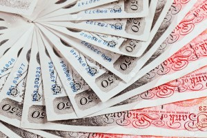 11511959-50-pound-sterling-bank-notes-closeup-view-business-background-Stock-Photo