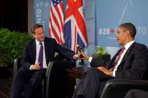 President Barack Obama and British Prime Minister David Cameron trade bottles of beer to settle a bet they made on the U.S. vs. United Kingdon World Cup Soccer game, during a bilateral meeting at the G20 Summit in Toronto, Canada, Saturday, June 26, 2010. (Official White House Photo by Pete Souza) This official White House photograph is being made available only for publication by news organizations and/or for personal use printing by the subject(s) of the photograph. The photograph may not be manipulated in any way and may not be used in commercial or political materials, advertisements, emails, products, promotions that in any way suggests approval or endorsement of the President, the First Family, or the White House.