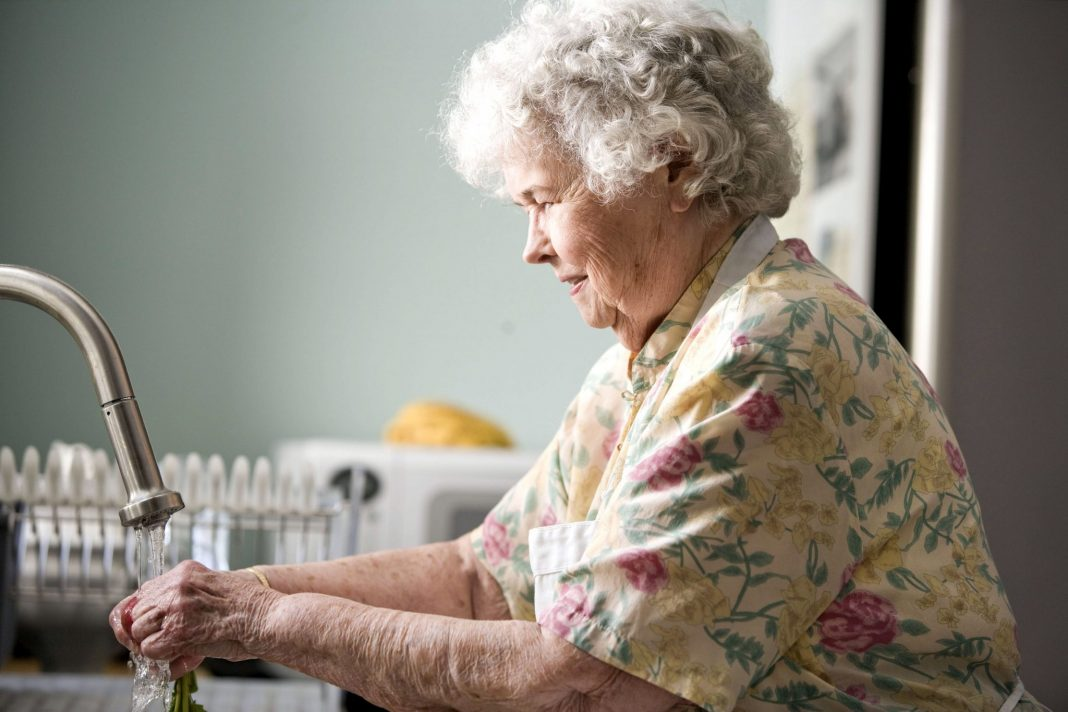 Portrait of old woman in kitchen