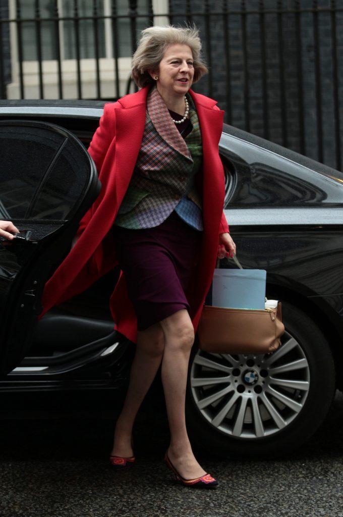 Theresa May exiting a car