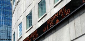 Financial market tickertape board outside city of London building