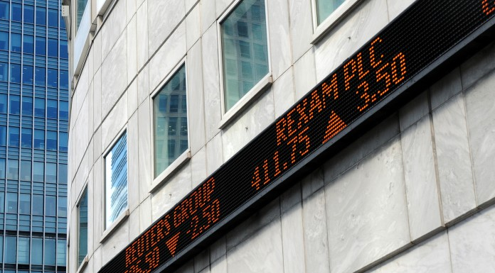 Financial market tickertape board outside city of London building