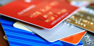 Colorful stack of credit cards and shopping gift cards. Macro w