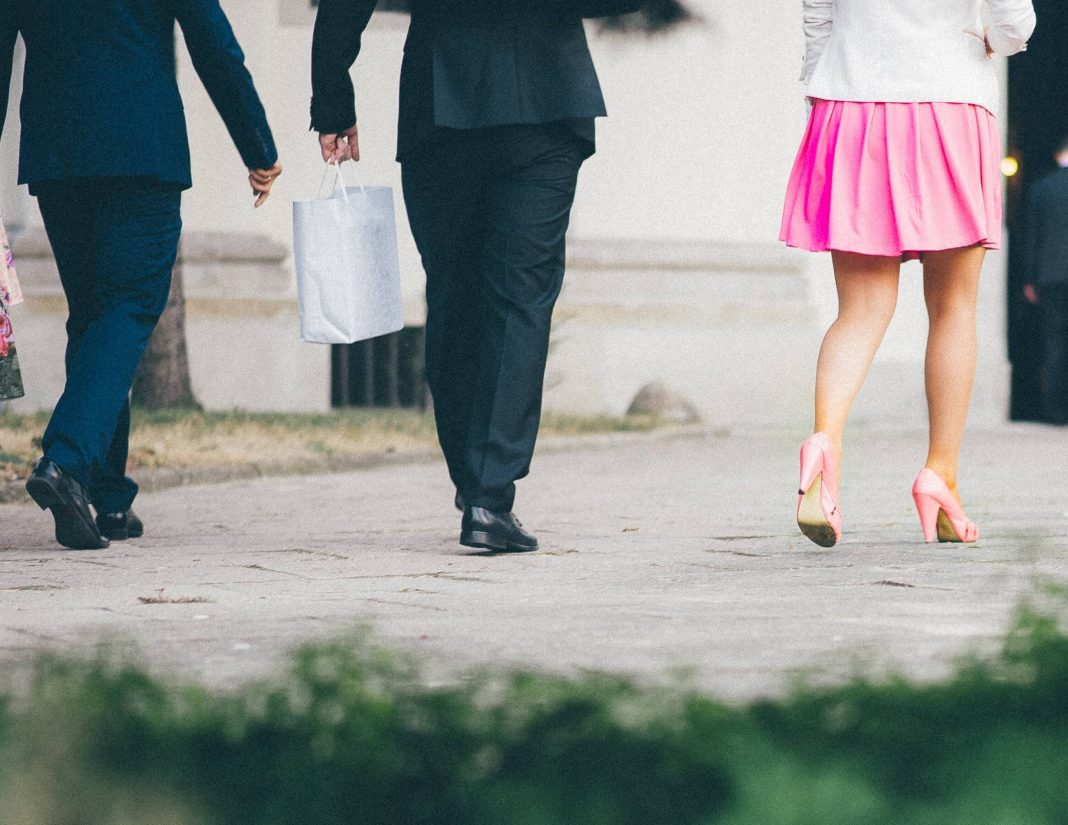 men in suits and woman in heels