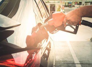 man putting fuel into car