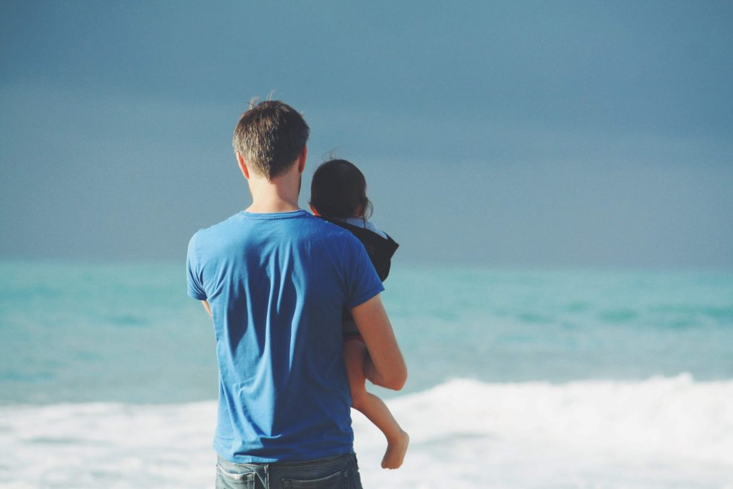 Father with child at the sea